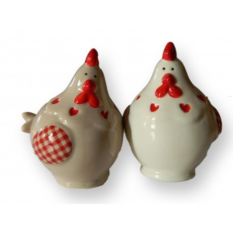Lot salière/poivrière en porcelaine en forme de poule.